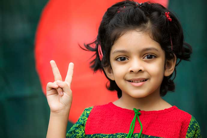 Cute Girl Showing victory infront of Bangladesh Flag