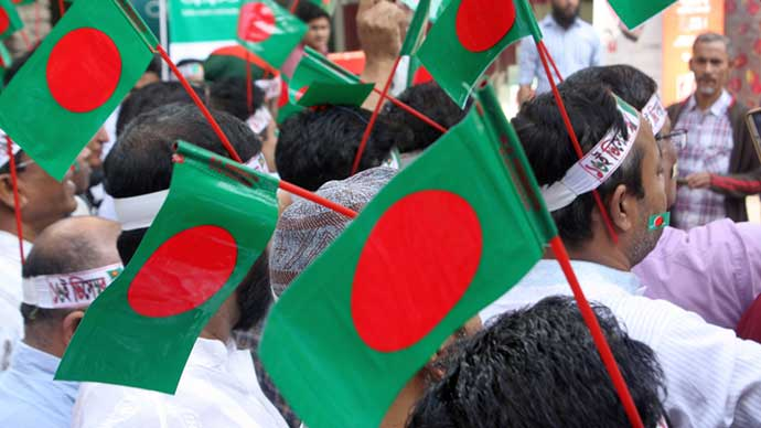 Students are celebrating victory day with Bangladesh Flag